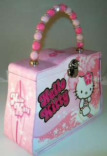 cute purse features hello kitty in a bathing suit surfing the waves
